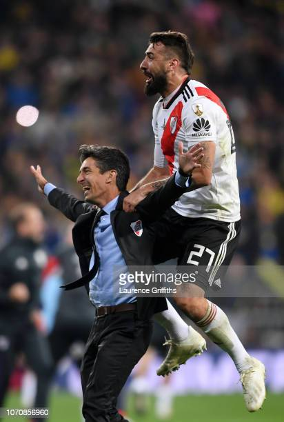 Lucas Pratto of River Plate and Hernan Bujan, Assistant Manager of River Plate celebrate following their sides victory in the second leg of the final...