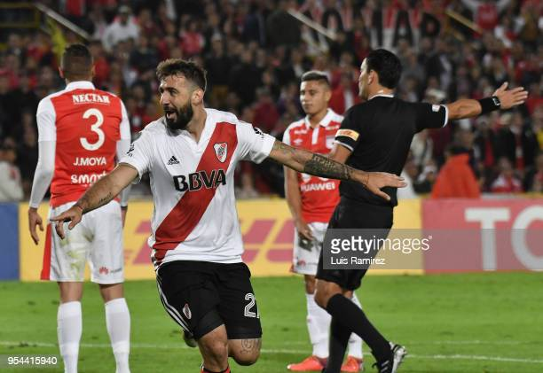 Lucas Pratto of River Plate celebrates after scoring the first goal of his team during a group stage match between Independiente Santa Fe and River...