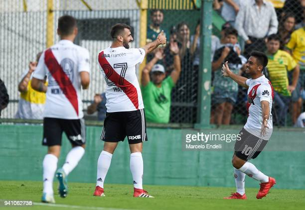 Lucas Pratto of River Plate celebrates with teammate Gonzalo Martinez after scoring the third goal of his team during a match between Defensa y...