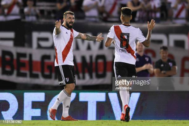 Lucas Pratto of River Plate celebrates with teammate Jorge Carrascal after scoring the third goal of his team during a match between River Plate and...