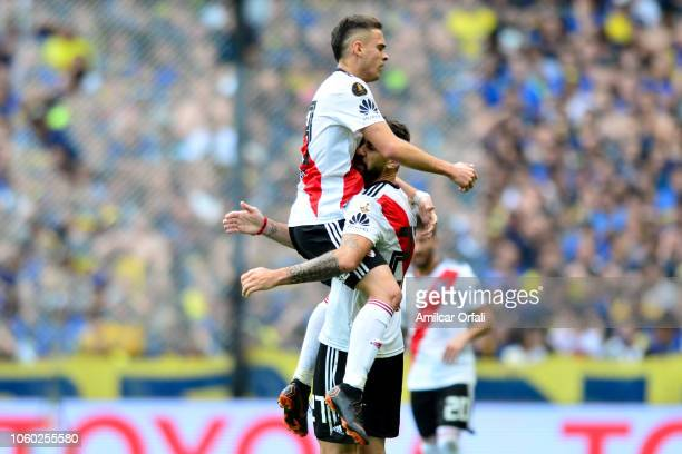 Lucas Pratto of River Plate celebrates with teammate Rafael Santos Borre after scoring the first goal of his team during the first leg match between...