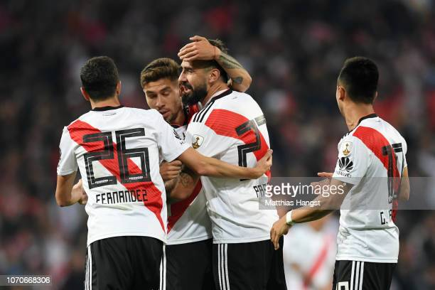 Lucas Pratto of River Plate celebrates with teammates after scoring his team's first goal during the second leg of the final match of Copa CONMEBOL...