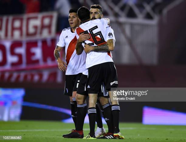 Lucas Pratto of River Plate celebrates with teammates Enzo Pérez and Ignacio Fernández after scoring the opening goal via penalty during a round of...