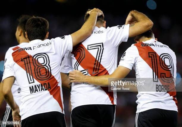 Lucas Pratto of River Plate celebrates with teammates Rafael Santos Borre and Camilo Mayada after scoring the second goal of his team during a match...