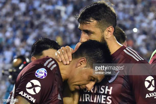 Lucas Pratto of River Plate comforts teammate Enzo Perez after equalizing a match between Atletico Tucuman and River Plate as part of Superliga...