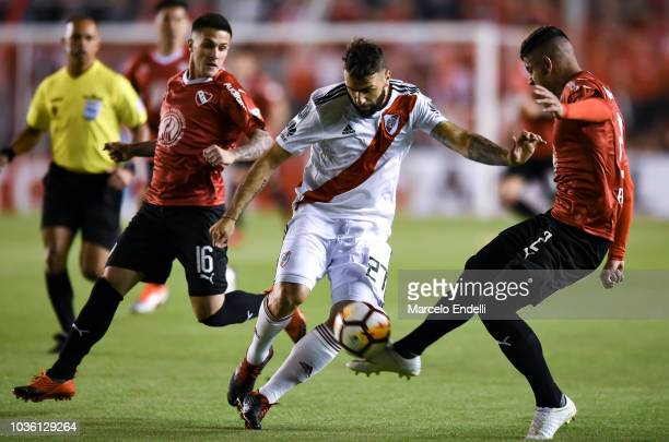Lucas Pratto of River Plate competes for the ball against Alan Franco of Independiente during a quarter final first leg match between Independiente...