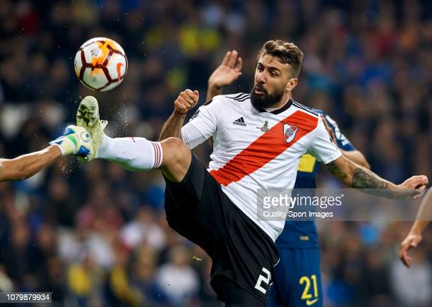 Lucas Pratto of River Plate competes for the ball with Esteban Andrada of Boca Juniors during the second leg of the final match of Copa CONMEBOL...
