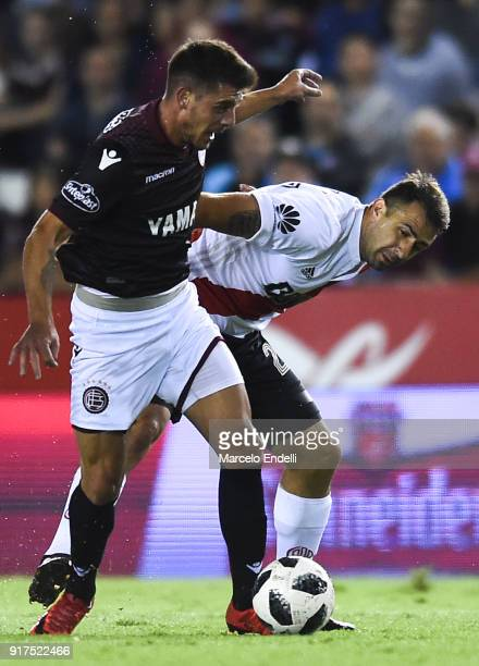 Lucas Pratto of River Plate fights for ball with Alejandro Silva of Lanus during a match between Lanus and River Plate as part of the Superliga...