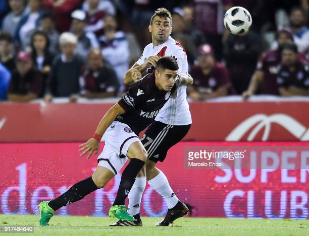 Lucas Pratto of River Plate fights for ball with Gabriel Carrasco of Lanus during a match between Lanus and River Plate as part of the Superliga...