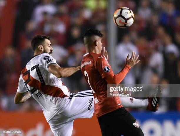 Lucas Pratto of River Plate fights for the ball with Alan Franco of Independiente during a quarter final first leg match between Independiente and...