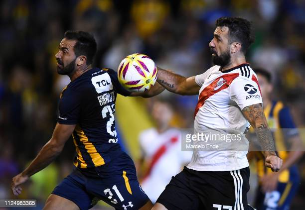 Lucas Pratto of River Plate fights for the ball with Fabian Rinaudo of Rosario Central during a match between Rosario Central and River Plate as part...
