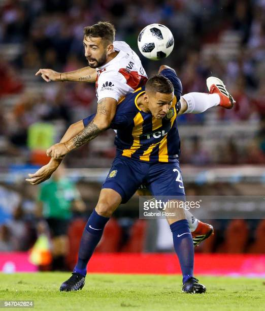 Lucas Pratto of River Plate fights for the ball with Fernando Tobio of Rosario Central during a match between River Plate and Rosario Central as part...
