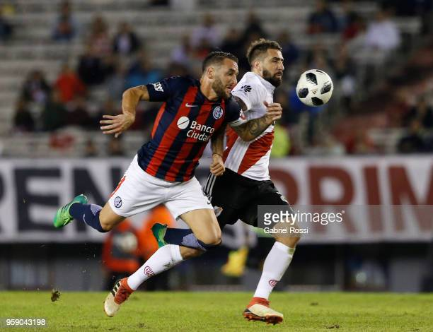 Lucas Pratto of River Plate fights for the ball with Gonzalo Rodriguez of San Lorenzo during a match between River Plate and San Lorenzo as part of...