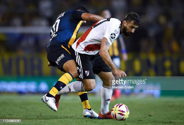 Lucas Pratto of River Plate fights for the ball with Nestor Ortigoza of Rosario Central during a match between Rosario Central and River Plate as...