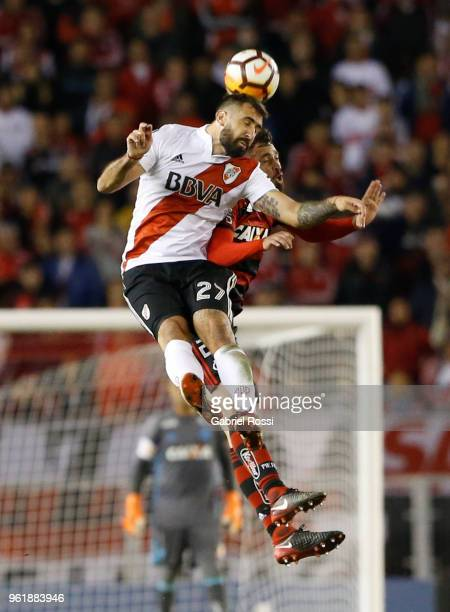 Lucas Pratto of River Plate goes for a header with Léo Duarte of Flamengo during a match between River Plate and Flamengo as part of Copa CONMEBOL...
