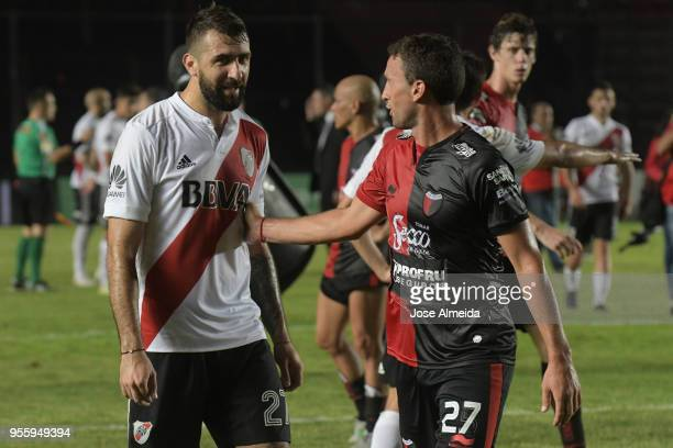 Lucas Pratto of River Plate greets Pablo Ledesma of Colon after a match between Colon and River Plate as part of Superliga at Brigadier General...