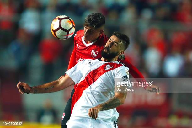 Lucas Pratto of River Plate heads the ball against Alan Franco of Independiente during a Quarter Final first leg match between Independiente and...