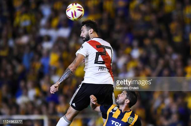 Lucas Pratto of River Plate heads the ball during a match between Rosario Central and River Plate as part of Superliga 2018/19 at Estadio Gigante de...