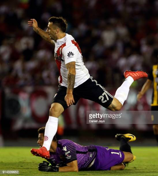 Lucas Pratto of River Plate jumps over Jorge Carranza of Olimpo as he misses a chance to score during a match between River Plate and Olimpo as part...