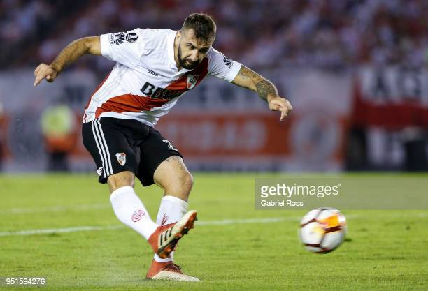 Lucas Pratto of River Plate kicks the ball to score the first goal of his team during a match between River Plate and Emelec as part of Copa CONMEBOL...