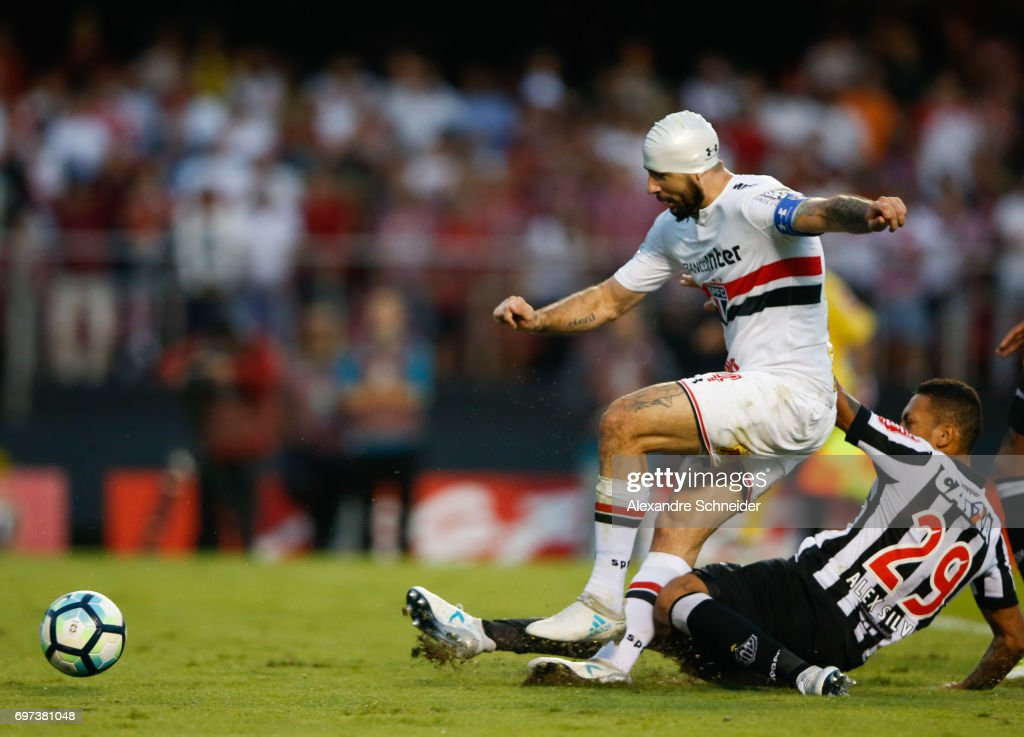 Lucas Pratto (L) of Sao Paulo and Alex Silva of Atletico MG in action during the match between Sao Paulo and Atletico MG for the Brasileirao Series A 2017 at Morumbi Stadium on June 18, 2017 in Sao Paulo, Brazil.