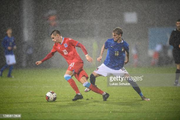 Lucas Prudhomme of Luxembourg challenges for the ball with Nicolo Rovella of Italy during the UEFA Euro Under 21 Qualifier match between Luxembourg...
