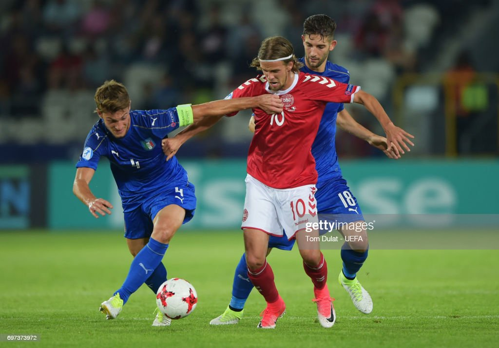 Lucas Qvistorff Andersen of Denmark and Daniele Rugani of Italy compete for the ball during the UEFA European Under-21 Championship Group C match between Denmark and Italy at Krakow Stadium on June 18, 2017 in Krakow, Poland.