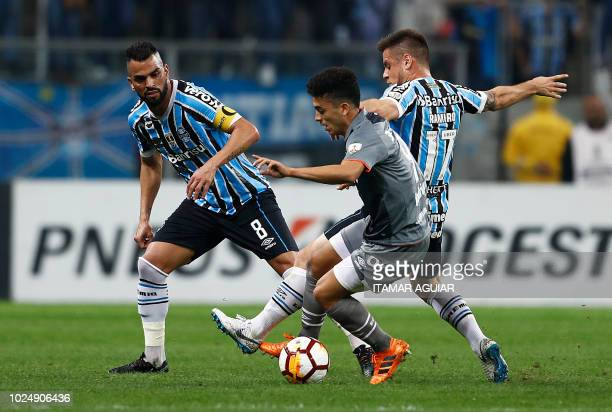Lucas Rodríguez of Argentina's Estudiantes vies for the ball with Ramiro of Brazil's Gremio during their Copa Libertadores 2018 football match held...