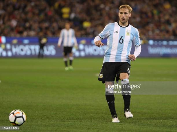 Lucas Rodrigo Biglia of Argentina passes the ball during the Brazil Global Tour match between Brazil and Argentina at Melbourne Cricket Ground on...
