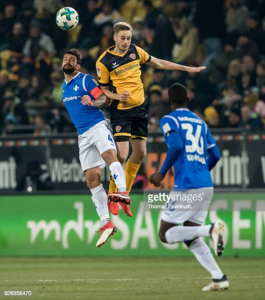 Lucas Roeser of Dresden is challenged by Aytac Sulu of Darmstadt during the Second Bundesliga match between SG Dynamo Dresden and SV Darmstadt 98 at...