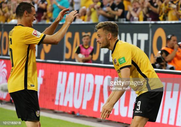 Lucas Roeser of Dresden jubilates with team mate Philip Heise after scoring the first goal during the Second Bundesliga match between SG Dynamo...