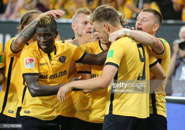 Lucas Roeser of Dresden jubilates with team mates after scoring the first goal during the Second Bundesliga match between SG Dynamo Dresden and MSV...
