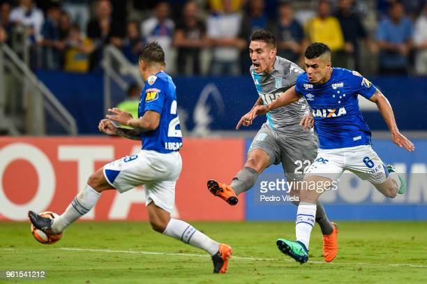 Lucas Romero and Egidio of Cruzeiro struggles for the ball with Centurion of Racing Club during a match between Cruzeiro and Racing Club as part of...