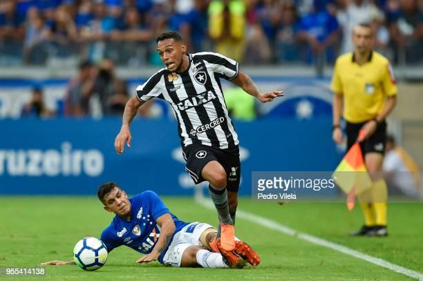 Lucas Romero of Cruzeiro and Gilson of Botafogo battle for the ball during a match between Cruzeiro and Botafogo as part of Brasileirao Series A 2018...