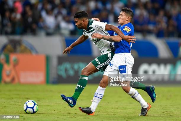 Lucas Romero of Cruzeiro and Thiago Santos of Palmeiras battle for the ball during a match between Cruzeiro and Palmeiras as part of Brasileirao...