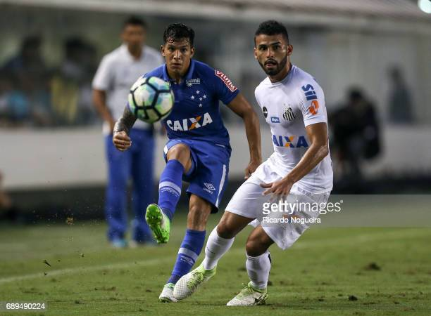 Lucas Romero of Cruzeiro battles for the ball with Thiago Maia of Santos during the match between Santos and Cruzeiro as a part of Campeonato...