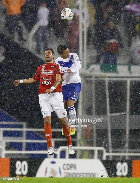 Lucas Romero of Velez Sarsfield heads the ball during a match between Velez Sarsfield and Nacional as part of round sixteen of Copa Bridgestone...