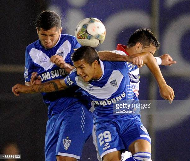 Lucas Romero of Velez Sarsfield jumps for the ball during a match between Nacional and Velez Sarsfield as part of round of sixteenth of Copa...