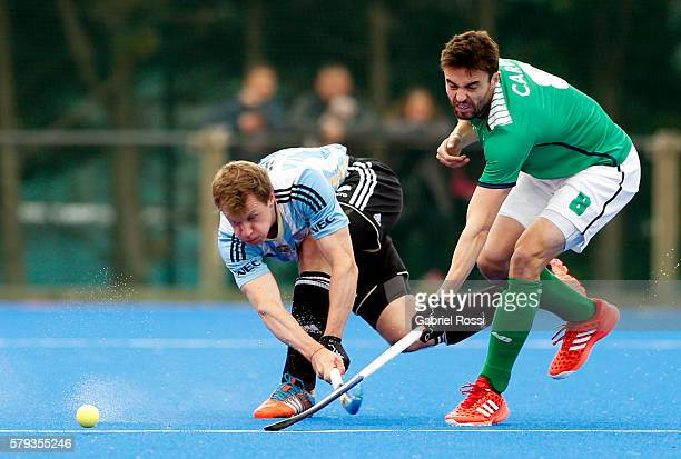 Lucas Rossi of Argentina fights for the ball with Chris Cargo of Ireland during an International Friendly match between Argentina and Ireland at...