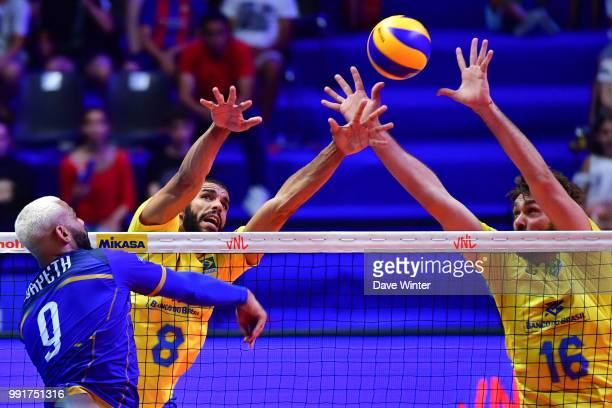 Lucas Saatkamp of Brasil Wallace De Souza of Brasil and Earvin Ngapeth of France during the Volleyball Nations League match between France and Brasil...