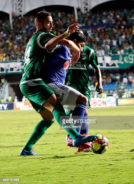 Lucas Scaglia of Deportivo Cali struggles for the ball with Dayro Moreno of Millonarios during a match between Deportivo Cali and Millonarios as part...