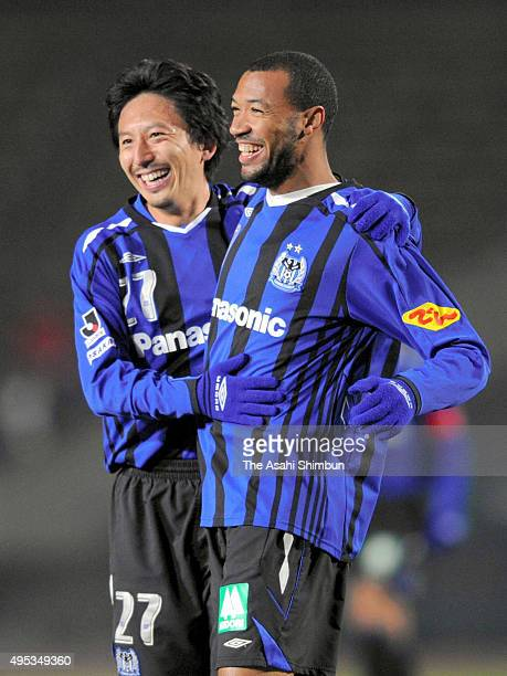 Lucas Severino of Gamba Osaka celebrates scoring his team's first goal with his team mate Hideo Hashimoto during the 88th Emperor's Cup quarter final...
