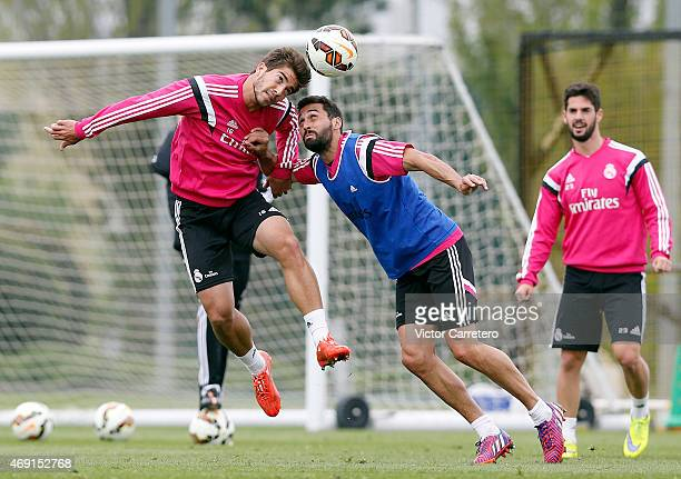 Lucas Silva and Alvaro Arbeloa of Real Madrid in action during a training session at Valdebebas training ground on April 10, 2015 in Madrid, Spain.