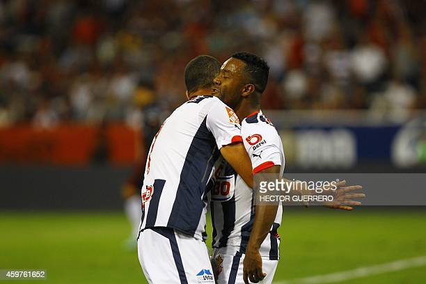 Lucas Silva and Dorlan Pavon of Monterrey celebrate after scoring against Atlas during a 2014 Mexican Apertura tournament football match in...