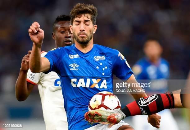 Lucas Silva of Brazil's Cruzeiro vies for the ball with Marlos Moreno of Brazil's Flamengo during their 2018 Copa Libertadores match at Mineirao...
