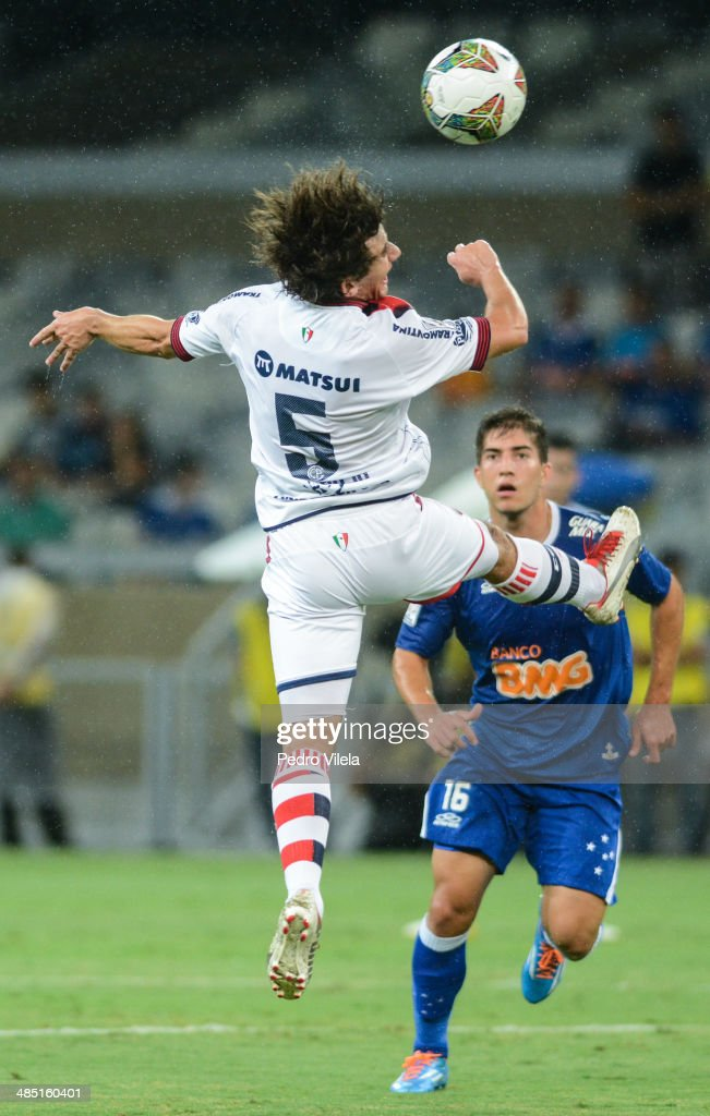 Lucas Silva of Cruzeiro and Corujo of Cerro Porteno during the match between Cruzeiro v Cerro Porteno for the Copa Briedgestone Liberators 2014 at Mineirao stadium on april 16, 2014 in Belo Horizonte, Brazil.