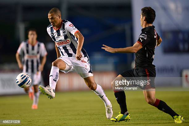 Lucas Silva of Monterrey fights for the ball with Facundo Erpen of Atlas during a match between Monterrey and Atlas as part of 10th round Apertura...