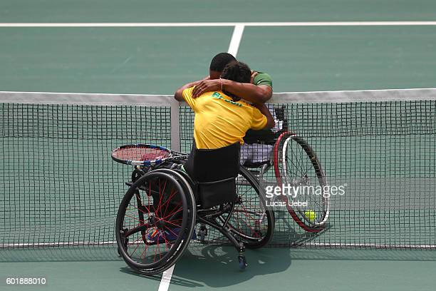 Lucas Sithole of South Africa and Ymanitu Silva of Brazil celebrate together after competing in the wheelchair tennis at central court on day 3 of...