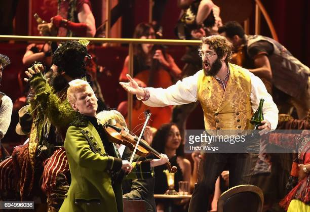 Lucas Steele and Josh Groban perform onstage with the cast of 'Natasha Pierre and The Great Comet of 1812' onstage during the 2017 Tony Awards at...
