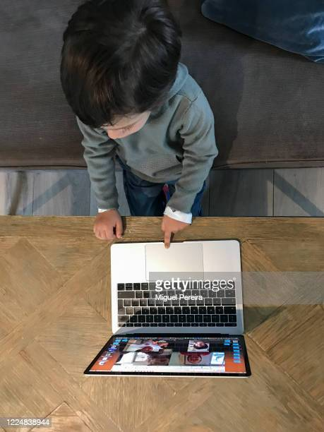 Lucas, the photographer's son, attends his daily class online during the Covid-19 lockdown on May 14, 2020 in Majadahonda, Madrid, Spain. Some parts...